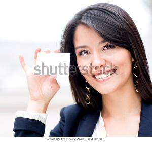 Friendly Woman Holding Business Card 600w 104385785
